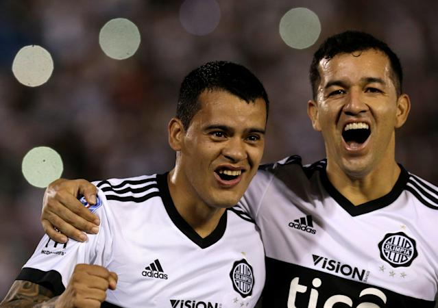 Soccer Football - Paraguayan Championship - Sol de America v Olimpia Asuncion - Defensores del Chaco stadium, Asuncion, Paraguay - May 27, 2018. William Mendieta (L) and teammate Nestor Camacho celebrate his goal against Sol de America. REUTERS/Jorge Adorno
