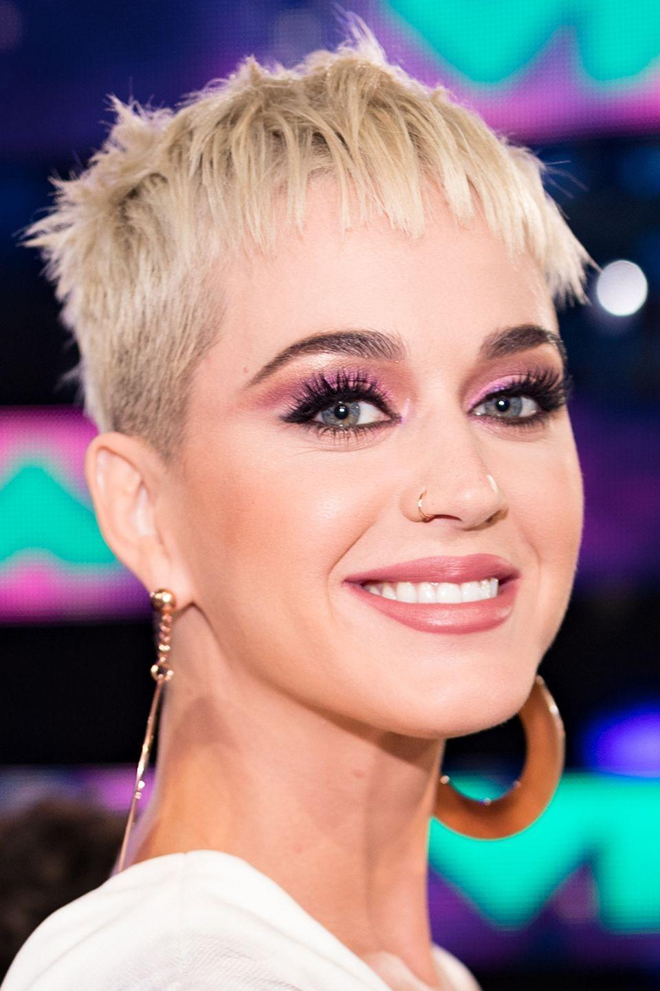 <p>Katy Perry has been sporting a platinum pixie cut lately, but it's hard not to think of her default hair color as almost-black.</p>