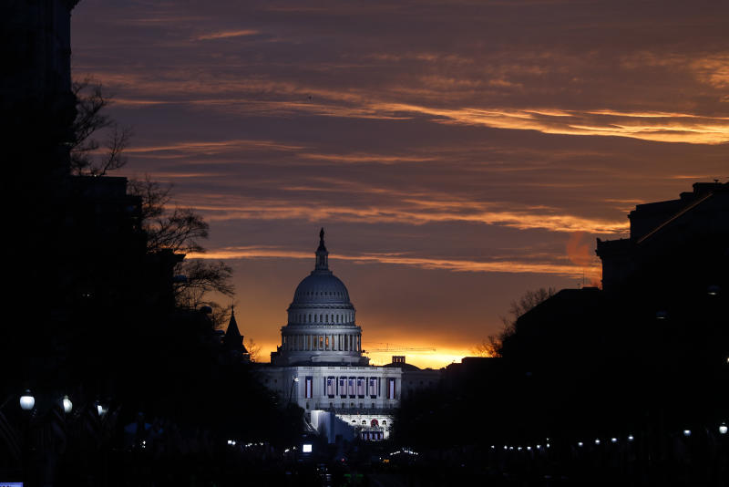 FILE - In this Friday, Jan. 20, 2017 file photo, the U.S. Capitol Building is illuminated during sunrise in Washington. The same Russian government-aligned hackers who penetrated the Democratic Party have spent the past few months laying the groundwork for an espionage campaign against the U.S. Senate, the cybersecurity firm Trend Micro said Friday, Jan. 12, 2018. (AP Photo/John Minchillo)