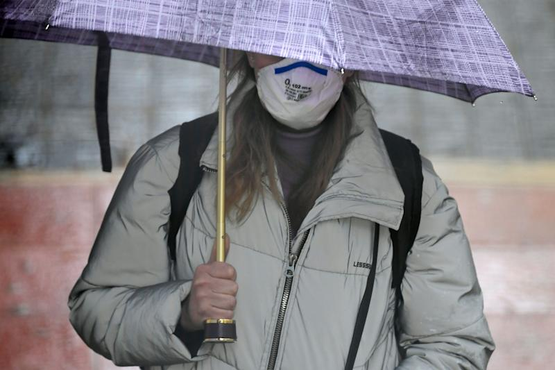 A person wearing a face mask as a preventive measure against the COVID-19 disease walks in Vilanova i la Geltru on March 30, 2020. - Spain confirmed another 812 deaths in 24 hours from the coronavirus today, a slight decline on the previous day's toll, bringing the total number of deaths to 7,340. The country, which has the world's second most deadly outbreak after Italy, recorded 838 deaths from the pandemic yesterday, its third straight daily record for coronavirus deaths. (Photo by LLUIS GENE / AFP) (Photo by LLUIS GENE/AFP via Getty Images)