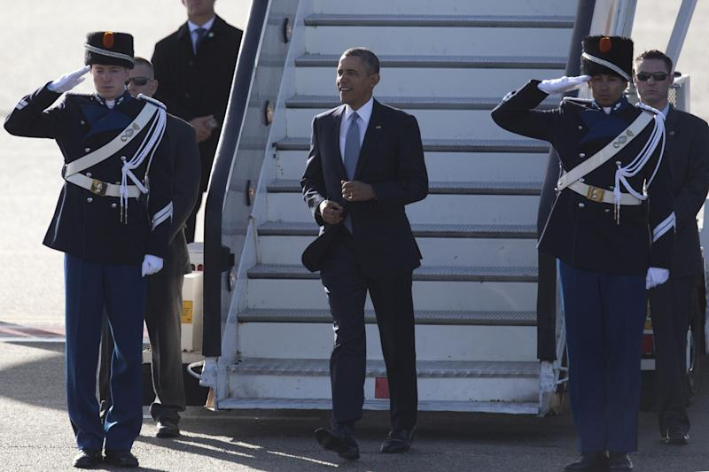 President Barack Obama walks down the stairs from Air Force One upon arrival at Schiphol Amsterdam Airport, Netherlands, Monday March 24, 2014. Obama will attend the two-day Nuclear Security Summit in The Hague. (AP Photo/Peter Dejong, POOL)