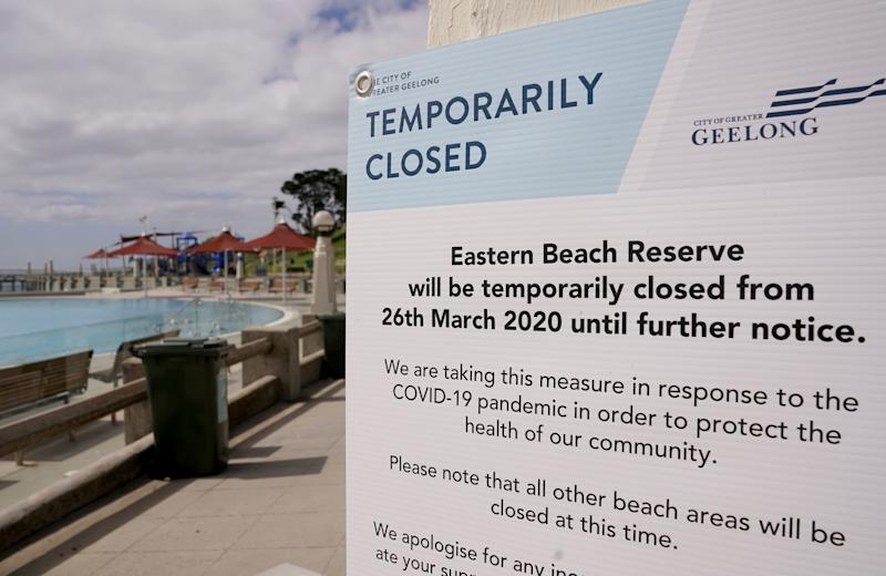 A sign informing people Eastern Beach in Geelong is closed in a bid to slow the spread of coronavirus. Source: AAP