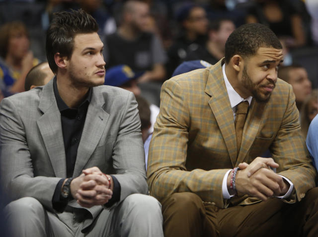 Apr 16, 2014; Denver, CO, USA; Denver Nuggets forward Danilo Gallinari (left) and center JaVale McGee (right) watch from the bench during the first quarter against the Golden State Warriors at Pepsi Center. (Chris Humphreys-USA TODAY Sports)