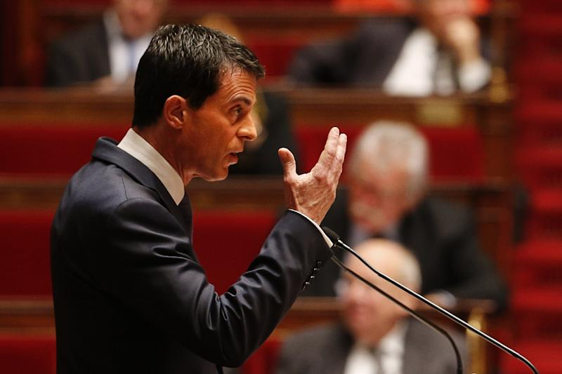 French Prime Minister Manuel Valls gestures as he addresses French lawmakers debating a measure that would extend a state of emergency declared by the French president until the end of February, at the National Assembly in Paris on November 19, 2015