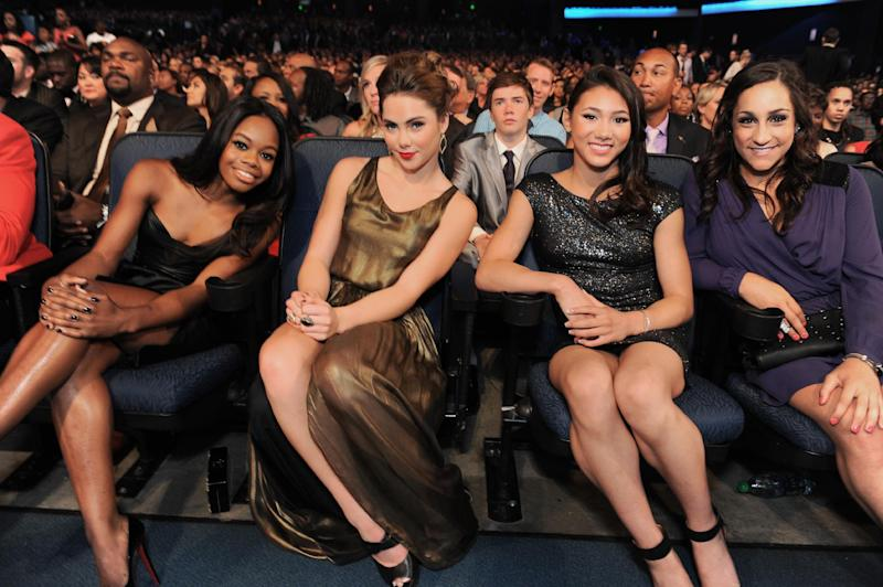 From left, gymnasts Gabby Douglas, McKayla Maroney, Kyla Ross and Jordyn Wieber pose in the audience at the ESPY Awards on Wednesday, July 17, 2013, at Nokia Theater in Los Angeles. (Photo by Jordan Strauss/Invision/AP)
