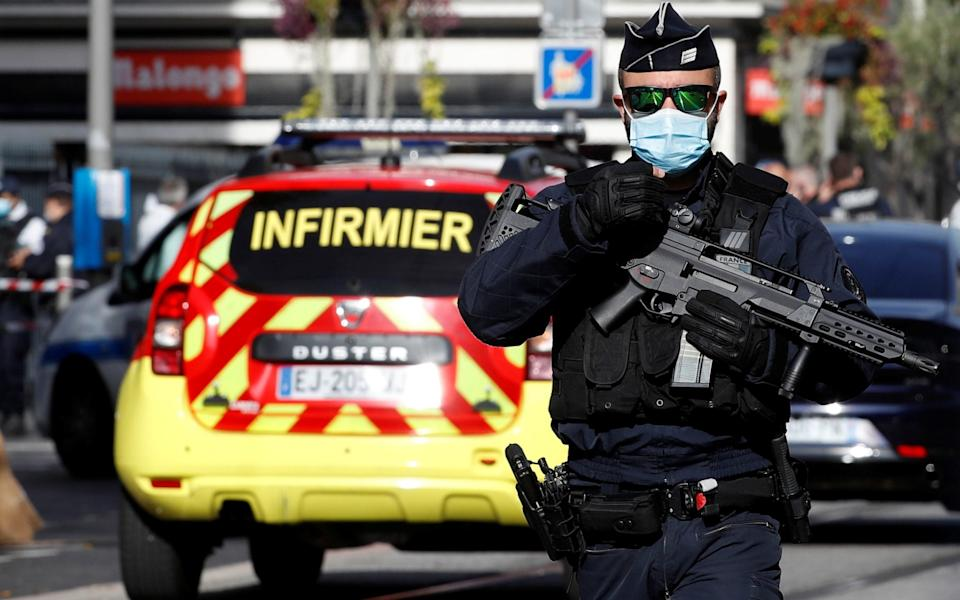A security officer guards the area after a reported knife attack at Notre Dame church in Nice - ERIC GAILLARD/REUTERS