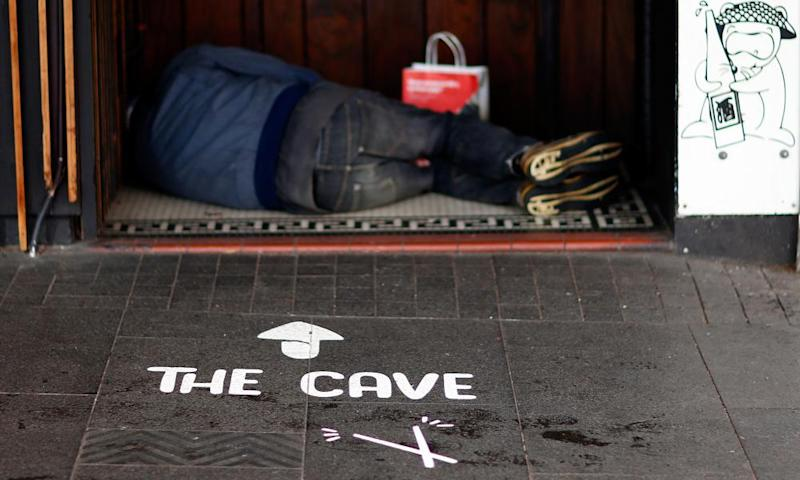 A homeless person sleeps in a doorway in the Auckland CBD.