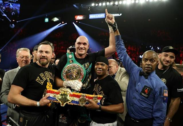 Top of the World - Tyson Fury has been invited both to the White House and to The Vatican following his defeat of Deontay Wilder his promoter told The Daily Telegraph (AFP Photo/AL BELLO)