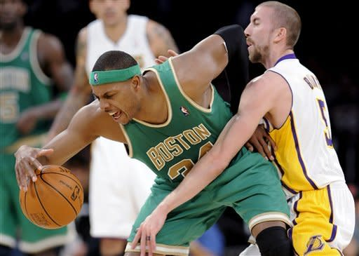 Boston Celtics forward Paul Pierce (34) and Los Angeles Lakers guard Steve Blake (5) fight for the ball in the first half of an NBA basketball game, Sunday, March 11, 2012, in Los Angeles. (AP Photo/Gus Ruelas)