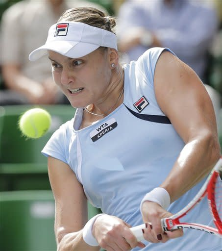 Nadia Petrova of Russia returns a ball against Sara Errani of Italy during her quarter-final match of the Pan Pacific Open Tennis in Tokyo Thursday, Sept. 27, 2012. (AP Photo/Koji Sasahara)