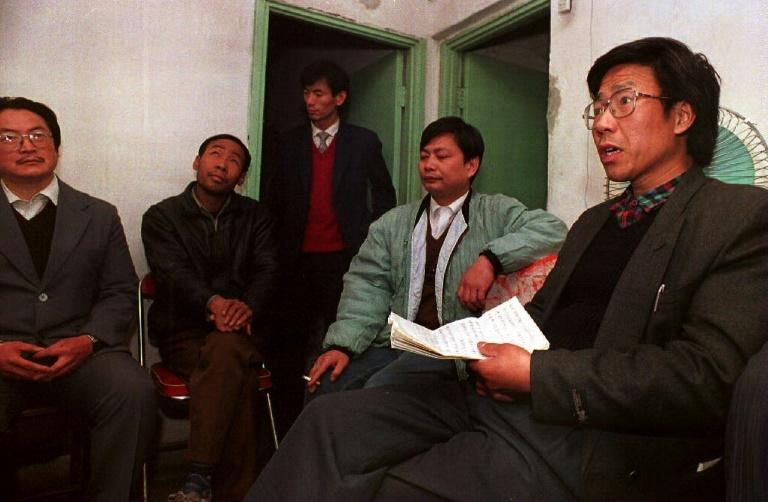 """Qin Yongmin (R), first jailed as a """"counter-revolutionary"""" from 1981-1989, has already spent a total of 22 years in prison"""