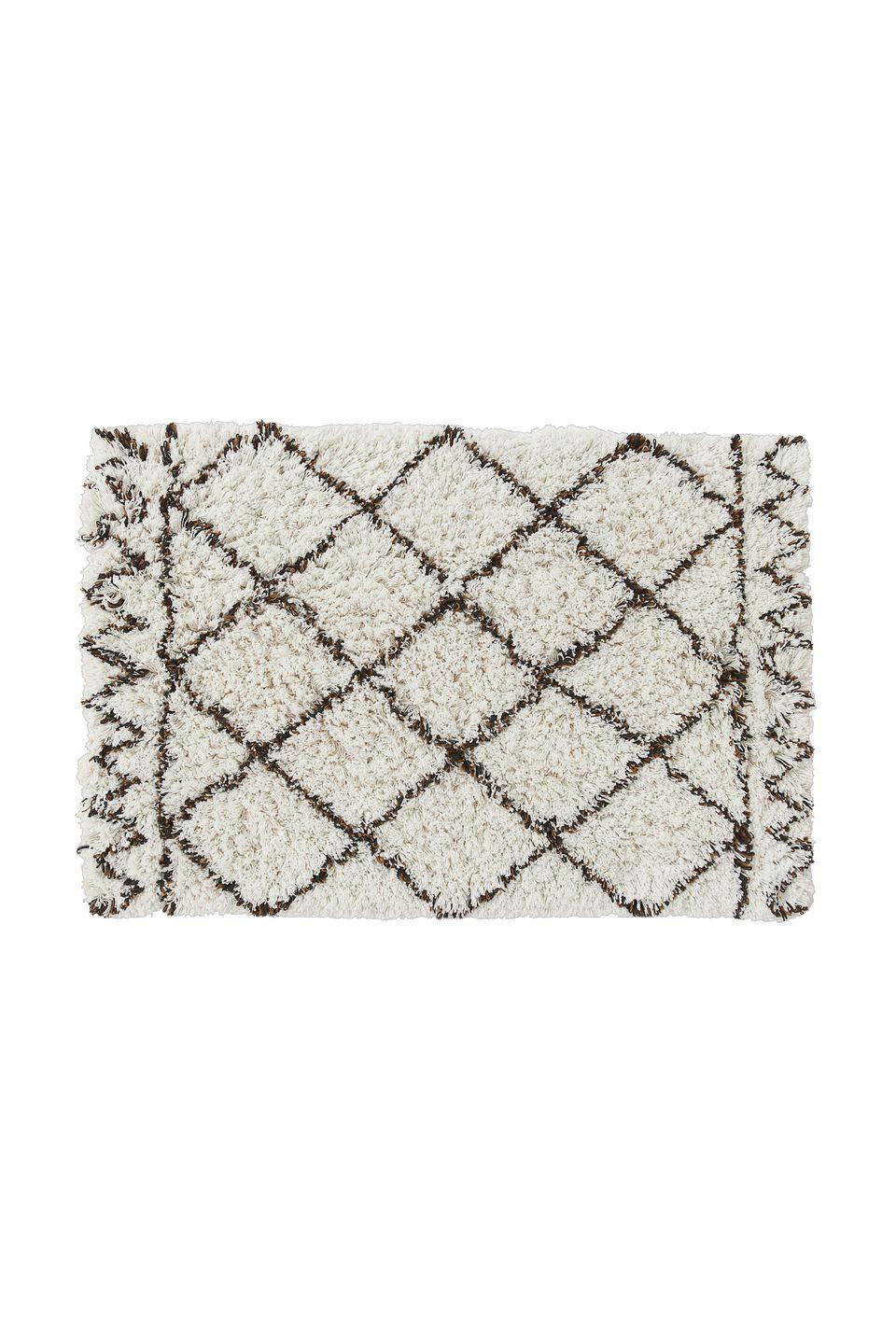 """<p>Alluding to the style of Berber rugs, made for more than 1,000 years by the Beni Ourain tribes in Morocco, this practical take on the traditional offers a deep-pile for luxurious bathroom comfort and non-slip feet. £17.99, <a href=""""https://www2.hm.com/en_gb/productpage.0759554001.html"""" rel=""""nofollow noopener"""" target=""""_blank"""" data-ylk=""""slk:hm.com"""" class=""""link rapid-noclick-resp"""">hm.com</a></p>"""