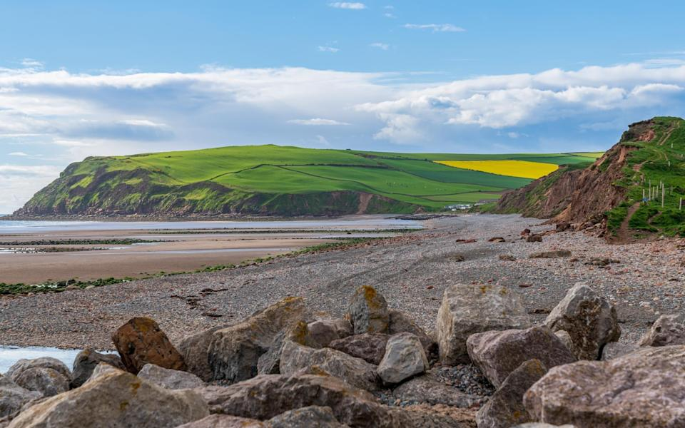 You don't have to choose between coast and country (pictured: the beach near Whitehaven) - Getty