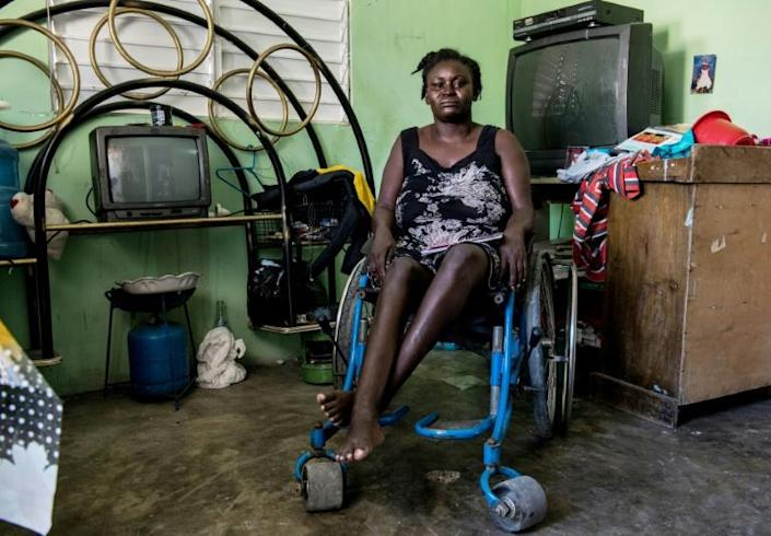 Herlande Mitile was left disabled by the deadly earthquake that struck Haiti in January 2010, and now, she says she feels forgotten by the government (AFP Photo/CHANDAN KHANNA)