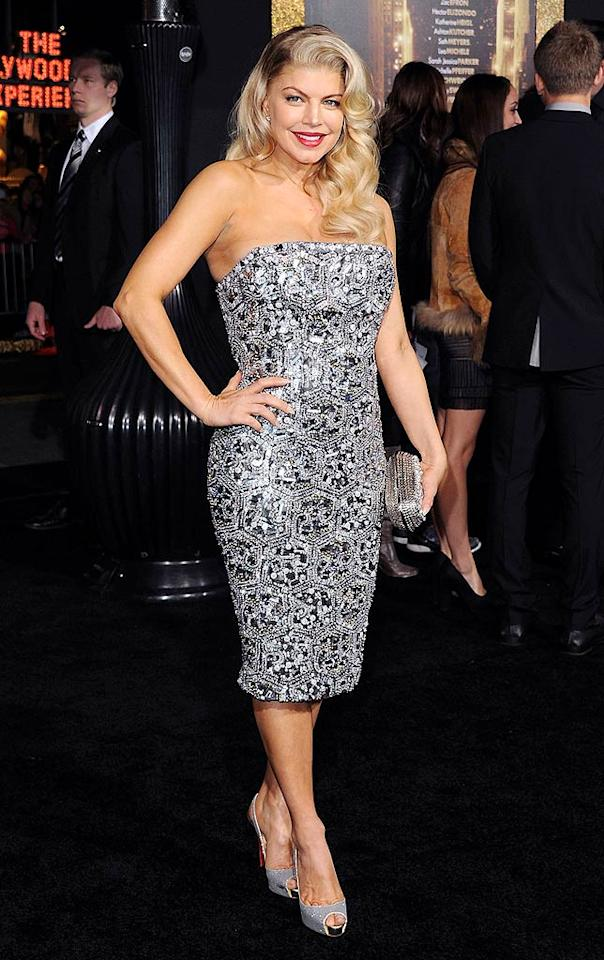 "Fergie oozed Old Hollywood glamour at the L.A. premiere for ""New Year's Eve"" in her mirrored Monique Lhuillier frock. Wavy long locks, red lips, sparkling silver Louboutins, and a Jimmy Choo clutch completed her sexy look. (12/05/2011)"