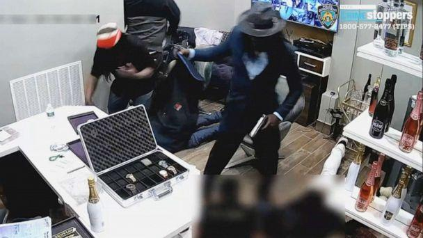 PHOTO: An image made from surveillance footage released by the New York Police Department shows three men robbing a jewelry store in Midtown Manhattan on Sunday, Aug. 25, 2019. (NYPD)
