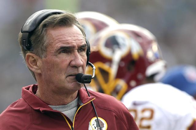 FILE - In this Nov. 17, 2013 file photo, Washington Redskins head coach Mike Shanahan watches the action during the first half of an NFL football game against the Philadelphia Eagles in Philadelphia. If these are indeed Mike Shanahan's final days with the Washington Redskins, his legacy will be one of an inability to make things work with his quarterbacks, from Donovan McNabb to Rex Grossman to John Beck to Robert Griffin III. (AP Photo/Matt Rourke)