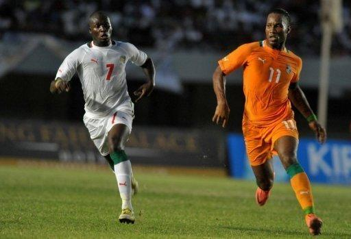 Didier Drogba (right) is tracked by Senegal's Moussa Sow during an Africa Cup qualifier in Dakar