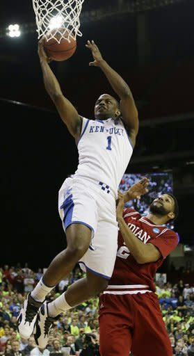 Kentucky's Darius Miller heads to the hoop as Indiana's Christian Watford (2) defends during the first half of an NCAA tournament South Regional semifinal college basketball game Friday, March 23, 2012, in Atlanta. (AP Photo/David J. Phillip)