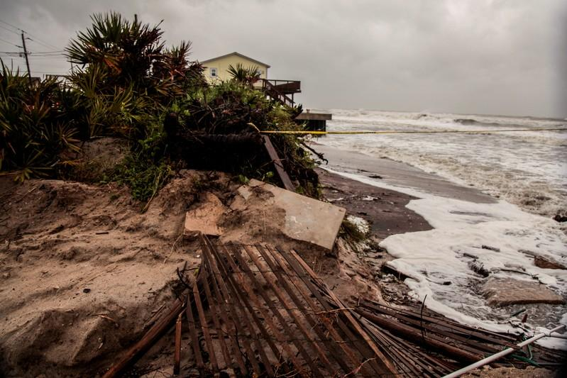 FILE PHOTO: Beach erosion and debris are seen due to Hurricane Dorian as the A1A coastal route of Vilano Beach is closed, in St. Augustine
