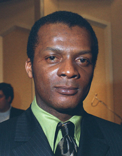 FILE-- Curt Flood, shown in this 1970 file photo, the star center fielder of the St. Louis Cardinals who challenged baseball's reserve system all the way to the U.S. Supreme Court. Flood set off the free-agent revolution 50 years ago Tuesday, Dec. 24, 2019, with a 128-word  letter to baseball Commissioner Bowie Kuhn, two paragraphs that pretty much ended the career of a World Series champion regarded as among the sport's stars but united a union behind his cause. (AP Photo/file)