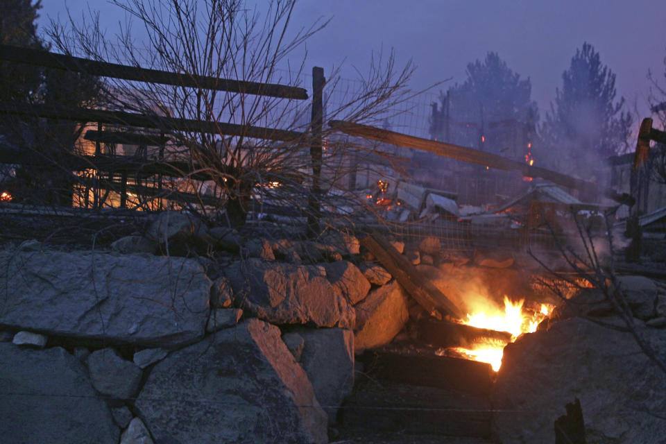 Wooden steps burn after wildfires in Southwest Reno, destroyed several homes in the Juniper Hills area. Tuesday, Nov.17, 2020, in Reno, Nev. (AP Photo/Lance Iversen)