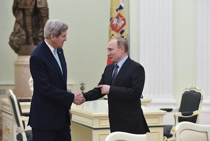 US Secretary of State John Kerry (L) shakes hands with Russia's President Vladimir Putin during a meeting at the Kremlin in Moscow on December 15, 2015 (AFP Photo/Mandel Ngan)