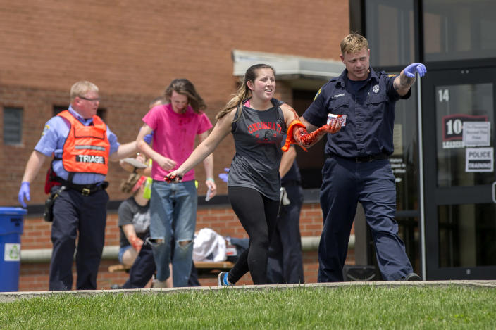 An emergency worker directs a volunteer with simulated injuries during a training exercise for an active shooter situation at Hopewell Elementary School in West Chester, Ohio, on May 25, 2016. (Photo: John Minchillo/AP)