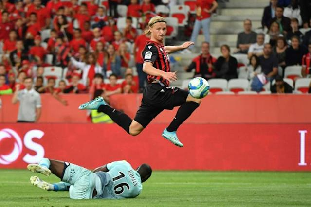 Nice's Kasper Dolberg celebrated his home debut with his first goal for the club (AFP Photo/YANN COATSALIOU)
