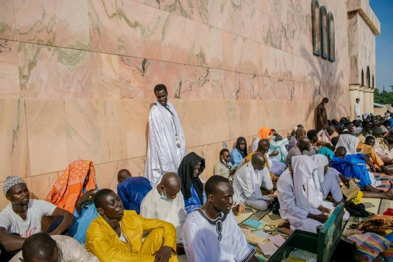 Pilgrims came to pray in the Great Mosque of Touba (AFP/CARMEN ABD ALI)