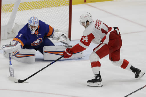 New York Islanders goaltender Thomas Greiss (1) poke checks Detroit Red Wings' Robby Fabbri (14) during the third period of an NHL hockey game Tuesday, Jan. 14, 2020, in Uniondale, N.Y. The Islanders won 8-2. (AP Photo/Frank Franklin II)