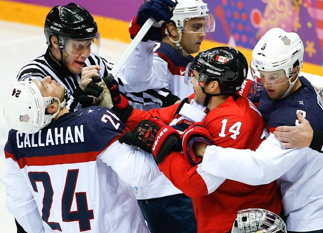 USA forward Ryan Callahan and Canada forward Chris Kunitz mix it up during the first period of the men's semifinal ice hockey game at the 2014 Winter Olympics, Friday, Feb. 21, 2014, in Sochi, Russia. (AP Photo/Matt Slocum)