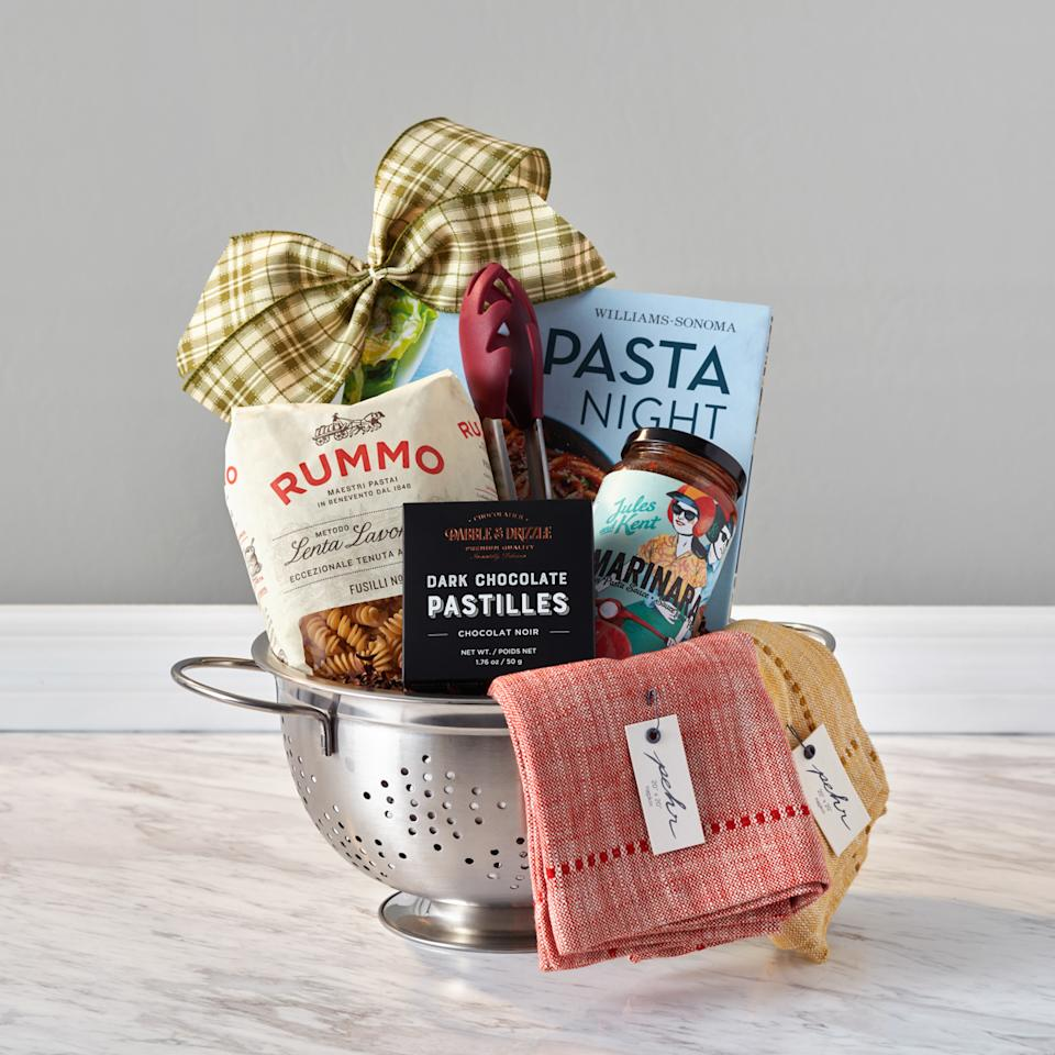 "<p></p><p>For the pasta lover, snap up this selection that includes a William Sonoma <em>Pasta Night</em> cookbook, authentic pasta sauce from Jules and Kent (Vancouver), silicone pasta tongs, RUMMO gourmet fusilli pasta noodles, Pehr Design napkins (Toronto), dark chocolate from fellow Canadian Dabble & Drizzle, and a stainless steel colander. <br /><a rel=""nofollow"" href=""https://www.baskits.com/pasta-night-g71518""><strong>SHOP IT: Baskits, $75</strong></a> </p><p></p>"