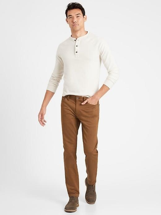 <p>OK, he may not be doing much <em>actual</em> traveling these days, but the <span>Banana Republic Athletic Tapered Heathered Traveler Pants</span> ($98-$99) look just as good close to home. </p>