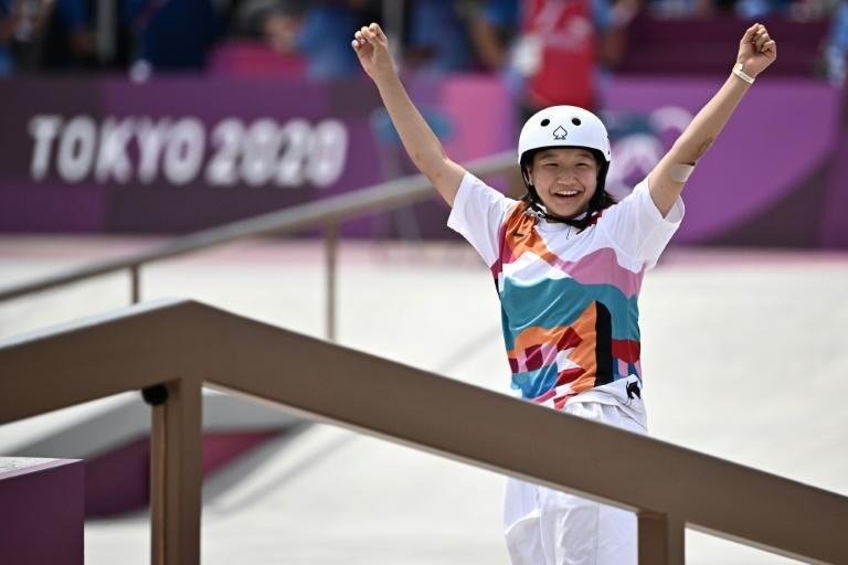 Japan's Momiji Nishiya celebrates en route to a gold medal in the skateboarding street final at the Olympics on Monday