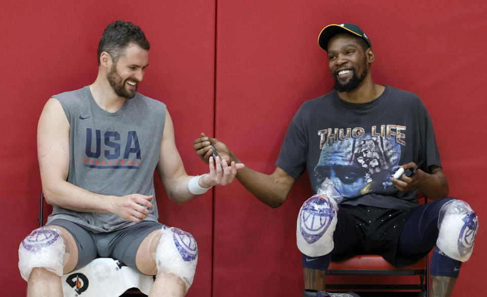 LAS VEGAS, NEVADA - JULY 07:  Kevin Love (L) #11 and Kevin Durant #7 of the 2021 USA Basketball Men's National Team share a laugh after a practice at the Mendenhall Center at UNLV as the team gets ready for the Tokyo Olympics on July 7, 2021 in Las Vegas, Nevada.  (Photo by Ethan Miller/Getty Images)