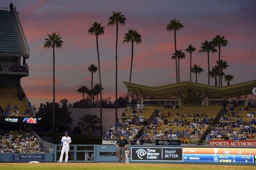 Los Angeles Dodgers shortstop Dee Gordon, left, stands on the field during the ninth inning of the Dodgers' baseball game against the San Francisco Giants, Wednesday, Oct. 3, 2012, in Los Angeles. The Dodgers won 5-1. (AP Photo/Mark J. Terrill)