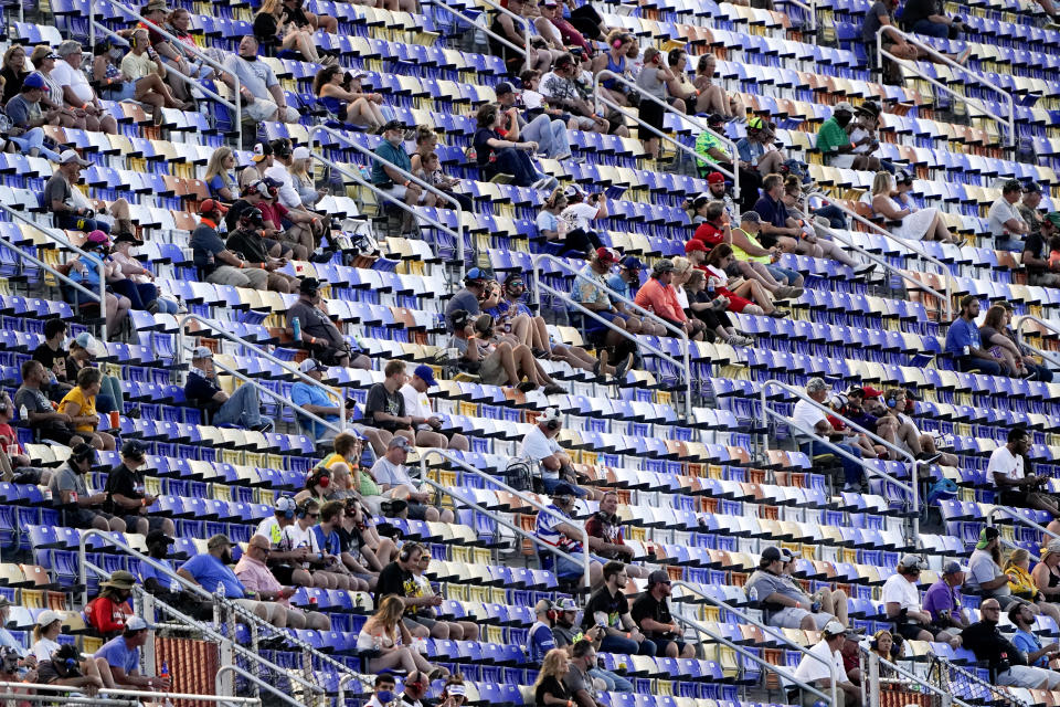 Fans watch the race during a NASCAR Cup Series auto race Sunday, Sept. 6, 2020, in Darlington, S.C. (AP Photo/Chris Carlson)