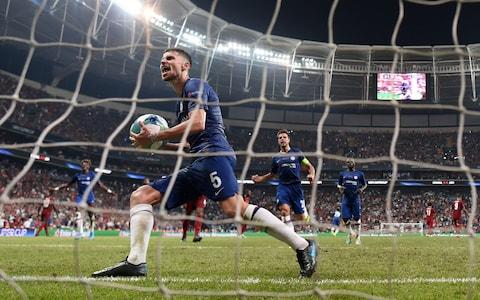 Jorginho picks up the ball having cooley slotted home his penalty. - Credit: Getty Images