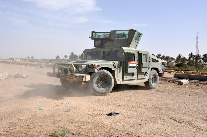 A picture taken on June 24, 2014 in the city of Ramadi in the Anbar province, shows an armored vehicle of government forces patrolling (AFP Photo/-)