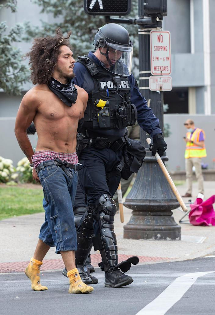 A man is arrested by Louisville Metro police after an attempt by protesters to block Liberty Street in downtown Louisville, Kentucky. June 17, 2020