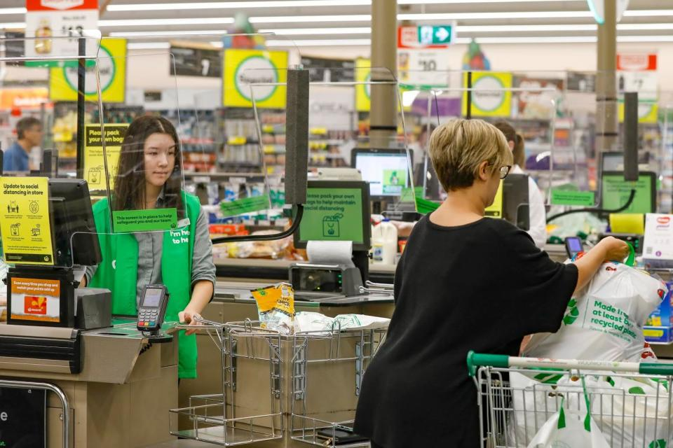 A Woolworths shopper fills her trolley with bags. Source: Woolworths