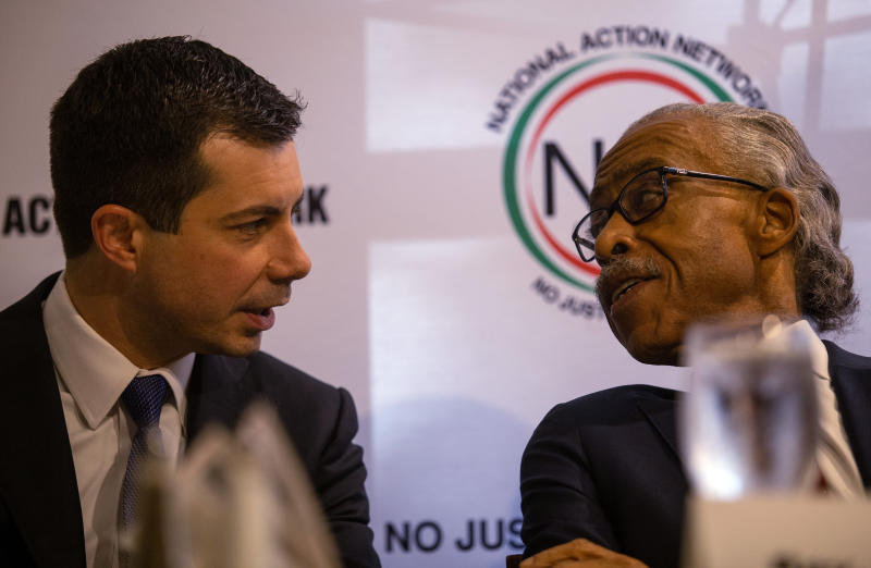 Pete Buttigieg, left, speaks with the Rev. Al Sharpton at a breakfast event on Thursday, November 21, 2019, in Atlanta. Buttigieg, along with Cory Booker, Amy Klobuchar, Andrew Yang and Tom Steyer, all presidential hopefuls, spoke at the event hosted by the Sharpton's National Action Network. (AP Photo/ Ron Harris)