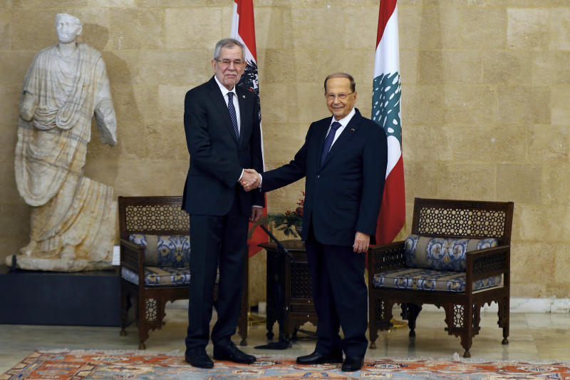 Lebanese President Michel Aoun, right, shakes hands with his Austrian counterpart Alexander Van Der Bellen, at the Presidential Palace in Baabda, east of Beirut, Lebanon, Tuesday, Dec. 11, 2018. (AP Photo/Bilal Hussein)