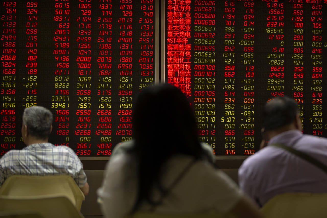 Chinese investors monitor stock prices at a brokerage house in Beijing, Friday, June 22, 2018. Asian stocks fell Friday following Wall Street losses overnight as investors were still wary over trade disputes between China and the U.S. as well as between the U.S. and Europe that could hurt corporate profit and jobs. (AP Photo/Mark Schiefelbein)