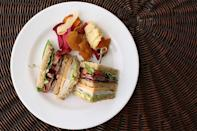 <p>Bacon, cheese, turkey, and avocado are just a few of the sturdy ingredients in this mighty club sandwich. It should hold for several hours - that is, if you can wait that long before diving into the triple decker of bread.</p>