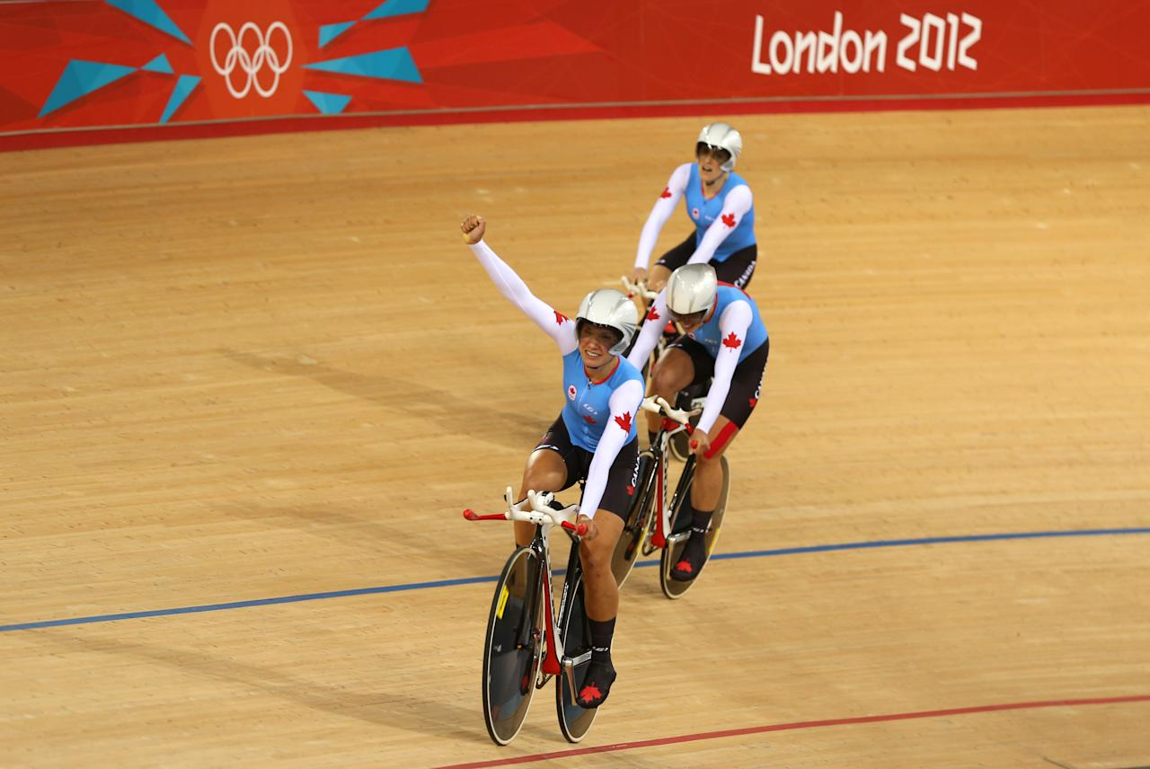 LONDON, ENGLAND - AUGUST 04:  (L-R) Tara Whitten, Gillian Carleton and Jasmin Glaesser of Canada celebrate winning the Bronze medal during the Women's Team Pursuit Track Cycling on Day 8 of the London 2012 Olympic Games at Velodrome on August 4, 2012 in London, England.  (Photo by Bryn Lennon/Getty Images)