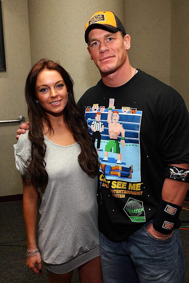 "Lindsay Lohan gets cozy with WWE Superstar John Cena backstage at a recent ""Monday Night Raw"" taping in Anaheim, CA. Jesse Grant/<a href=""http://www.wireimage.com"" target=""new"">WireImage.com</a> - February 18, 2008"