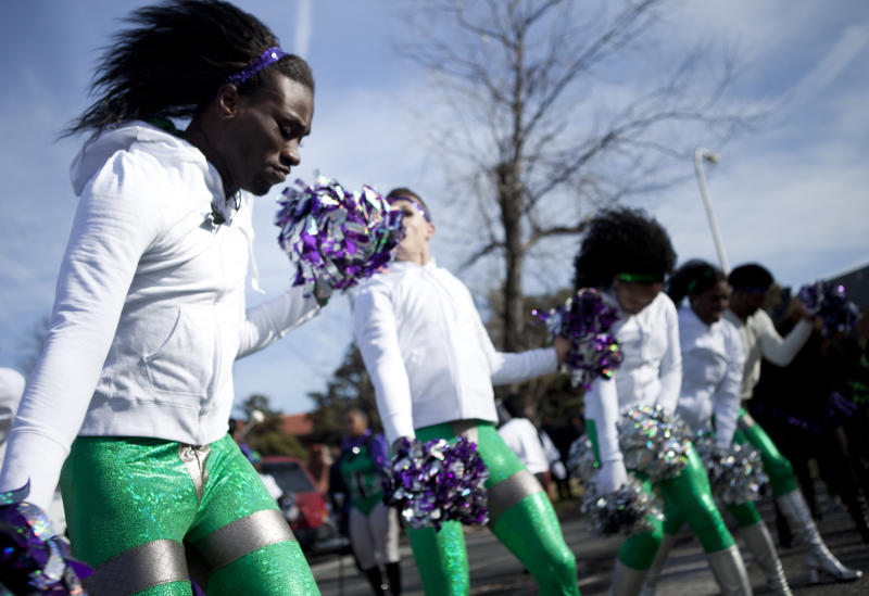 WASHINGTON, DC - JANUARY 16:  Members of the Enfuzion marching unit participate in a Martin Luther King Day parade January 16, 2012 in Washington, DC.  The parade of local politicians, civil rights activists, marching bands and others returned to Martin Luther King Avenue Southwest after an eight year hiatus.  (Photo by Brendan Smialowski/Getty Images)