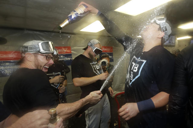 Tampa Bay Rays' Eric Sogard, left, celebrates with Ji-Man Choi after the Rays defeated the Oakland Athletics in an American League wild-card baseball game in Oakland, Calif., Wednesday, Oct. 2, 2019. (AP Photo/Jeff Chiu)